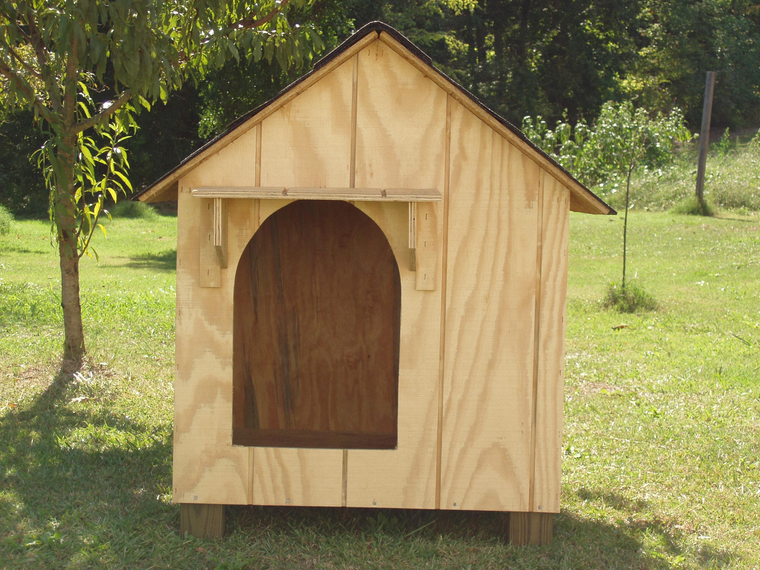 large wooden dog house
